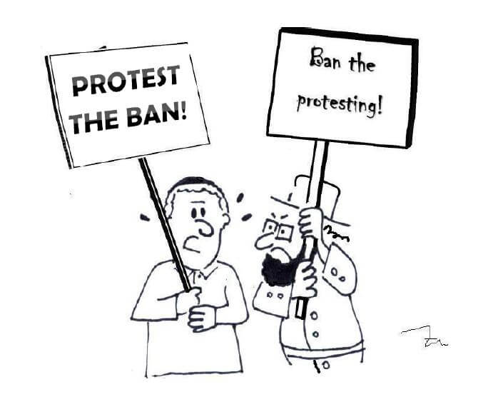 "Somone holding a sign saying ""protest the ban"" while a Hasidic Jew holds a sign saying ""ban the protest"""